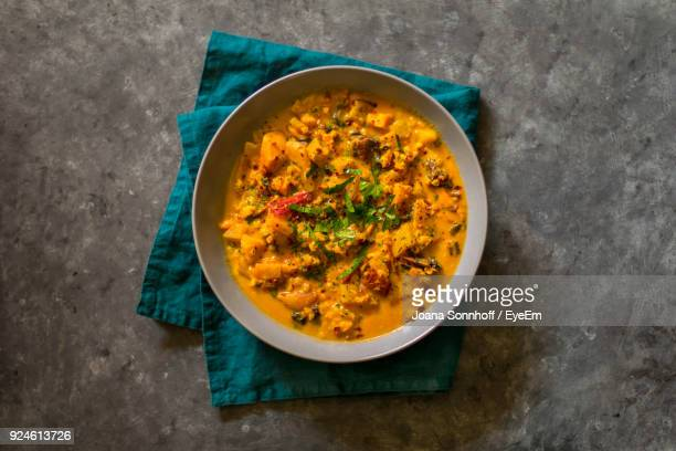 directly above shot of food in bowl on table - indian food stock photos and pictures