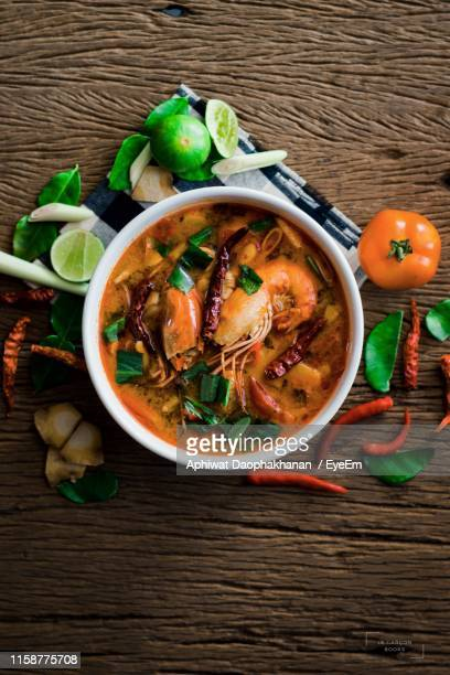 directly above shot of food in bowl with ingredients on table - thai food stock pictures, royalty-free photos & images