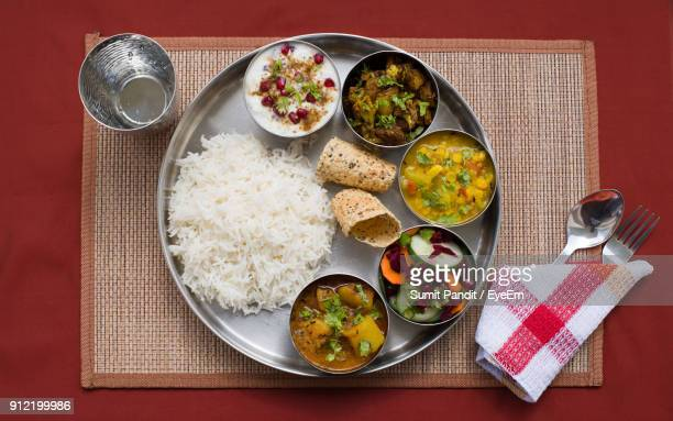directly above shot of food in plate on table - indian food stock photos and pictures
