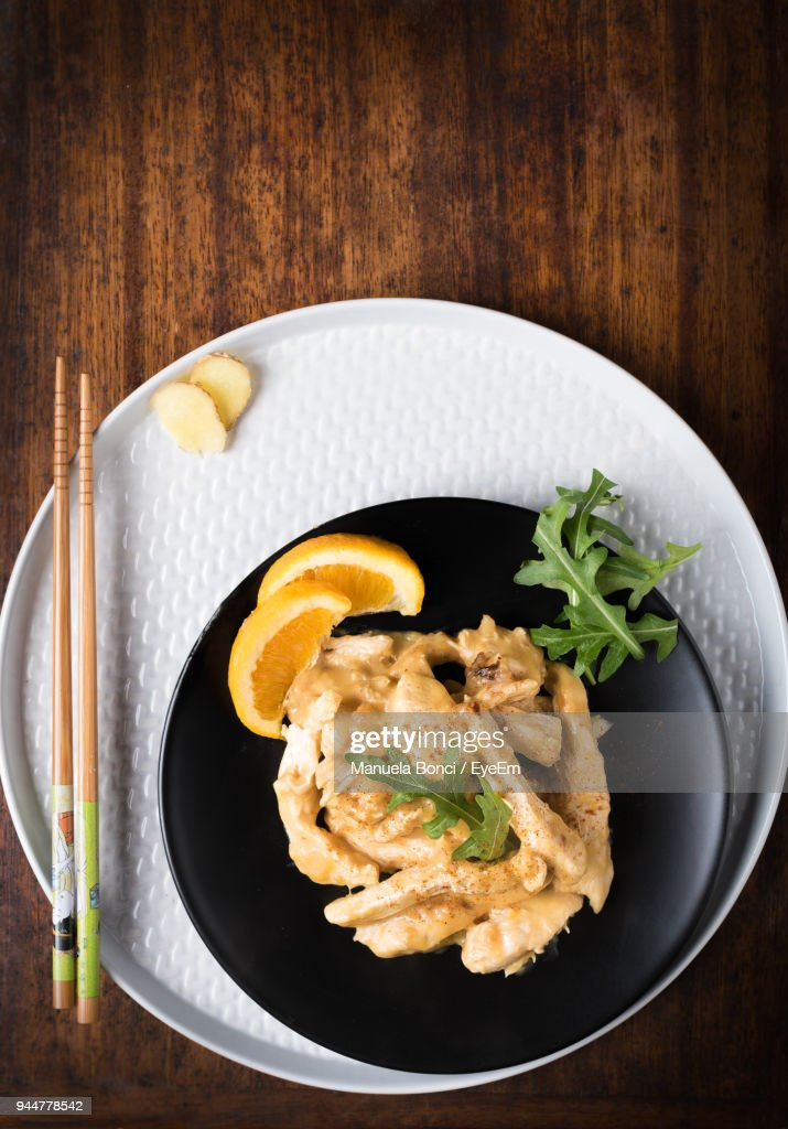 Directly Above Shot Of Food In Plate With Chopsticks On Table : Stock Photo