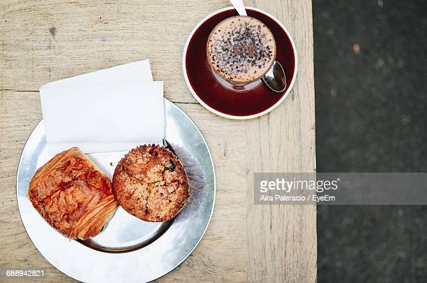 Directly Above Shot Of Food In Plate With Coffee On Table