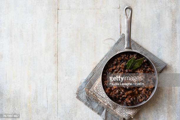 Directly Above Shot Of Food In Sauce Pan On Wooden Table