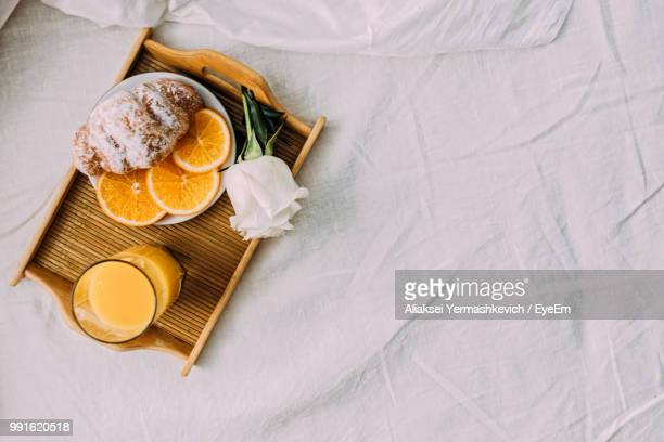 directly above shot of food on bed - breakfast in bed stock pictures, royalty-free photos & images
