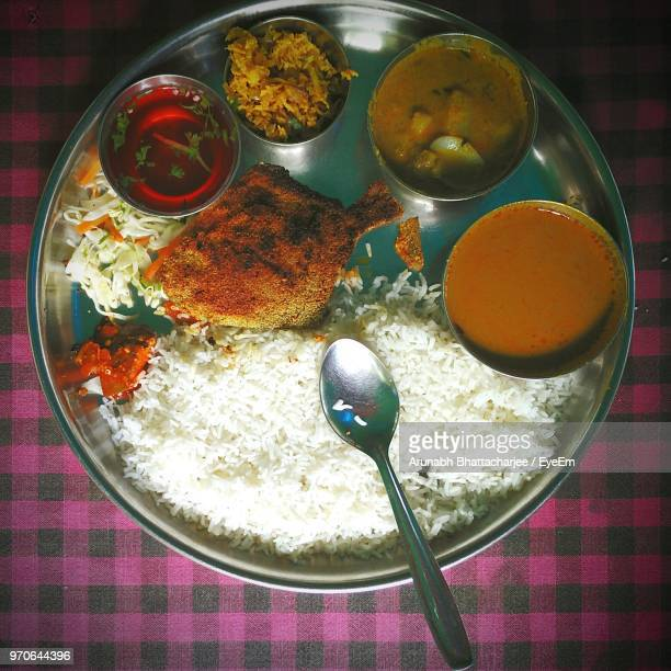 directly above shot of food served in plate on tablecloth - goa stock photos and pictures