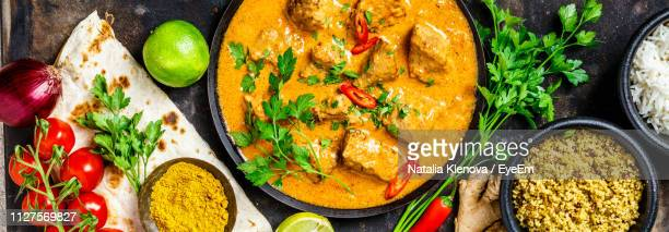 directly above shot of food served on table - indian food stock photos and pictures