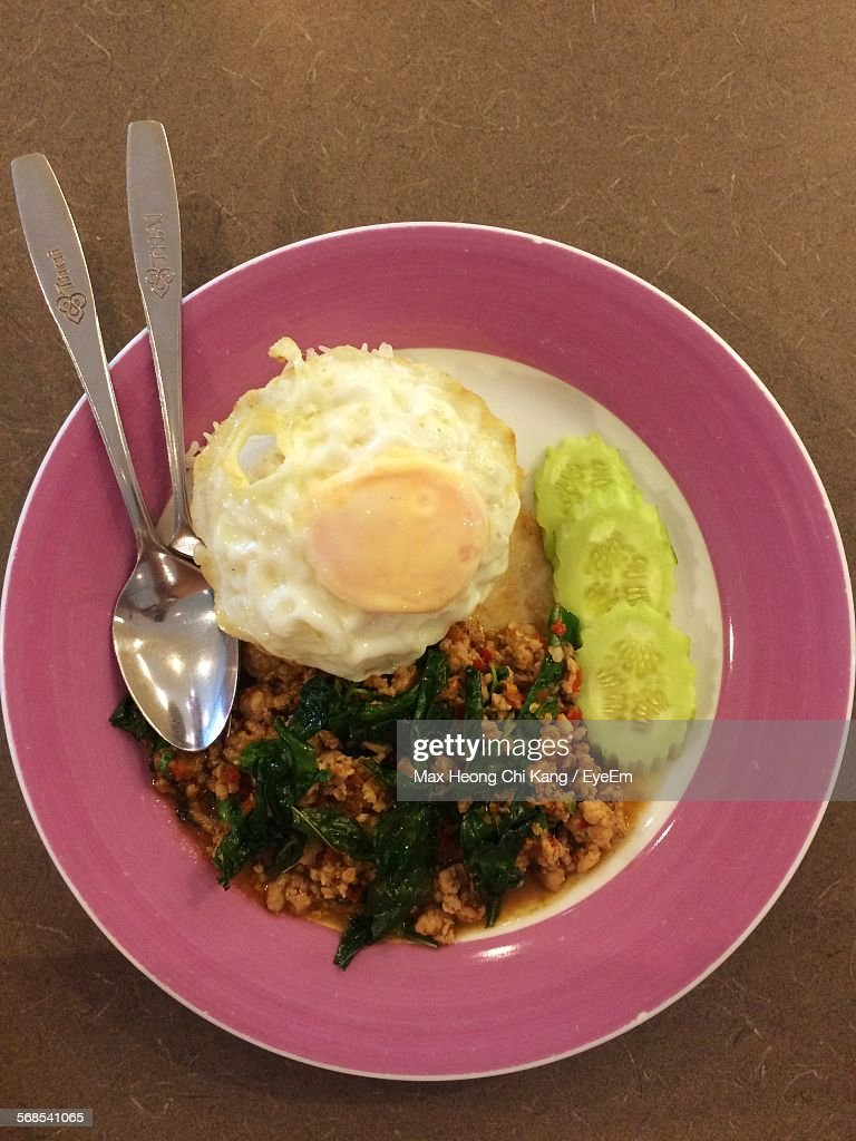 Directly Above Shot Of Food With Spoons In Plate : Stock Photo