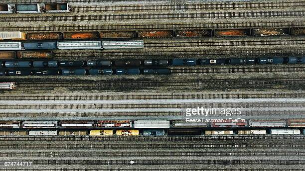 directly above shot of freight trains at shunting yard - shunting yard stock photos and pictures