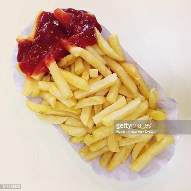 Directly Above Shot Of French Fries In Plate On Table