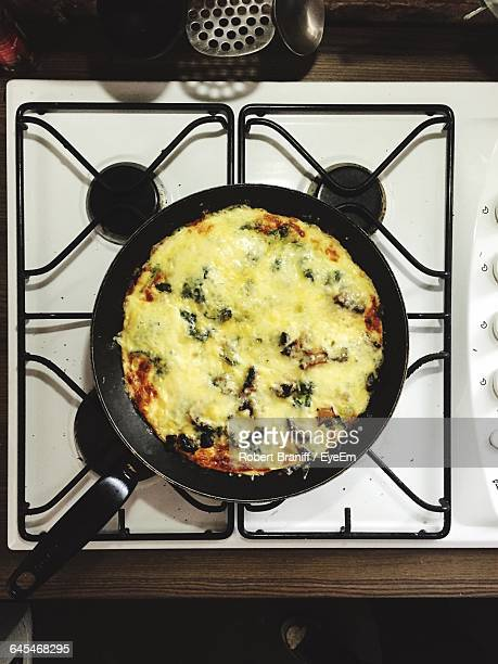 Directly Above Shot Of French Omelet In Frying Pan On Gas Stove Burner
