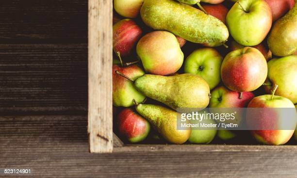 Directly Above Shot Of Freshly Harvested Pears And Apples In Crate