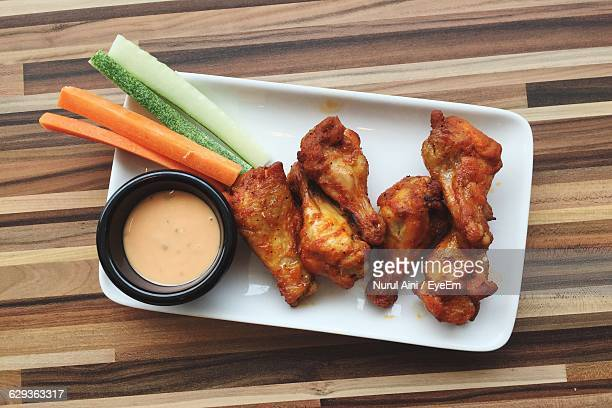 Directly Above Shot Of Fried Chicken Served With Sauce In Plate