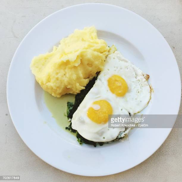 Directly Above Shot Of Fried Eggs In Plate On Table