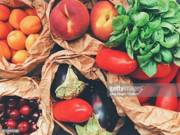 directly above shot of fruits and vegetables in paper bags - grocery bag stock pictures, royalty-free photos & images
