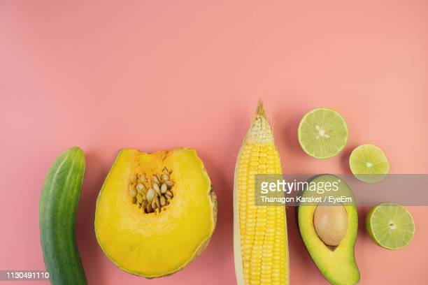 directly above shot of fruits and vegetables on colored background - two tone color stock pictures, royalty-free photos & images