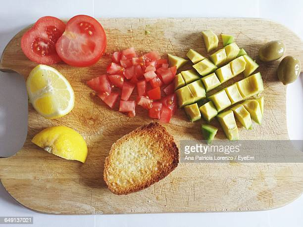 Directly Above Shot Of Fruits And Vegetables On Cutting Board