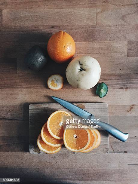 Directly Above Shot Of Fruits And Vegetables On Hardwood Floor