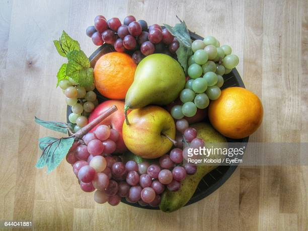 Directly Above Shot Of Fruits In Bowl On Hardwood Floor