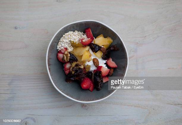 directly above shot of fruits in bowl on table - paulien tabak stock pictures, royalty-free photos & images