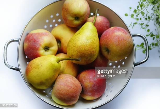 directly above shot of fruits in bowl - pear stock pictures, royalty-free photos & images