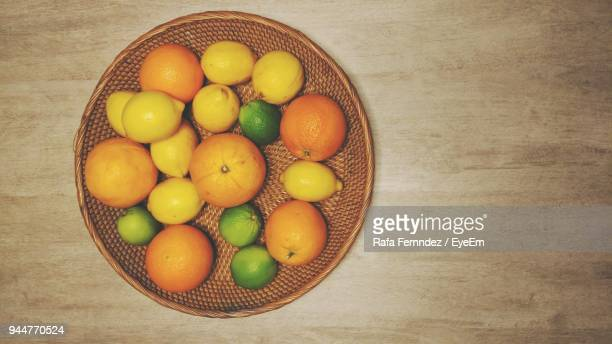 Directly Above Shot Of Fruits In Wicker Basket On Table