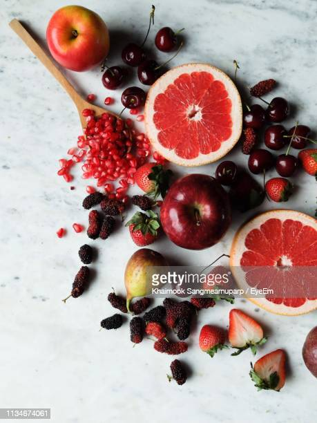 directly above shot of fruits on table - grapefruit red stock pictures, royalty-free photos & images