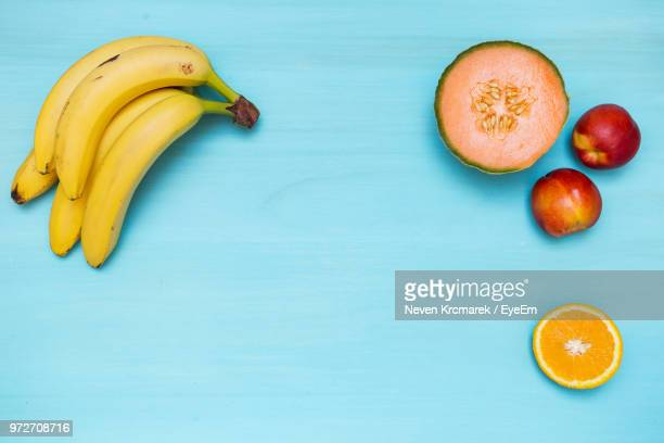 Directly Above Shot Of Fruits On Turquoise Background