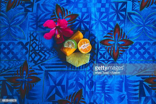 directly above shot of fruits served with flower in circle plate on table - samoa stock pictures, royalty-free photos & images