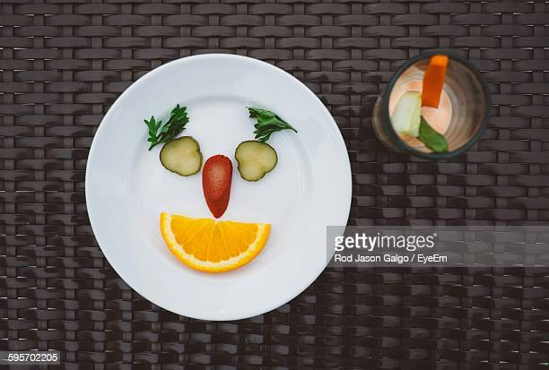 Directly Above Shot Of Fruits Slices In Plate On Wicker Table