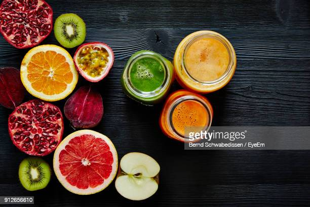 directly above shot of fruits with smoothie in jars on table - grapefruit red stock pictures, royalty-free photos & images