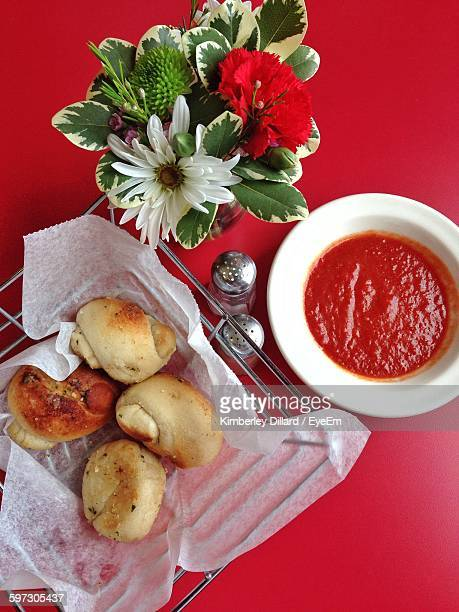 Directly Above Shot Of Garlic Bread And Sauce Served On Table