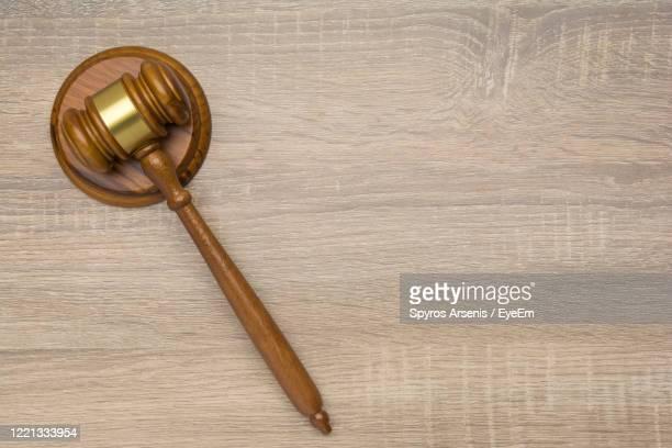 directly above shot of gavel on table - gavel stock pictures, royalty-free photos & images