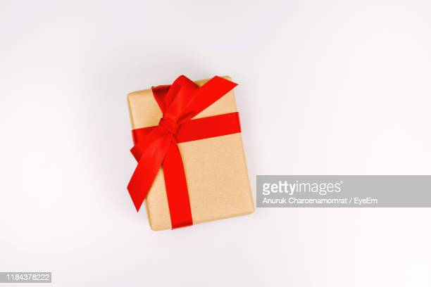 directly above shot of gift box against white background - gifts stock pictures, royalty-free photos & images