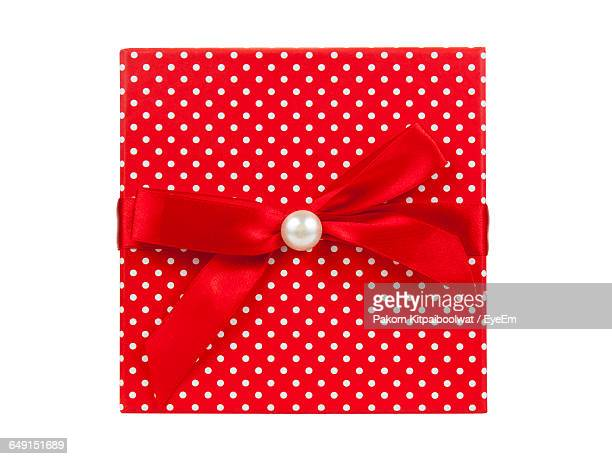 Directly Above Shot Of Gift Box With Red Ribbon Against White Background