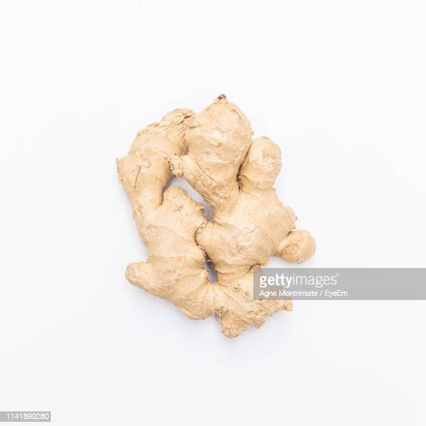 directly above shot of ginger against white background - ginger spice stock pictures, royalty-free photos & images