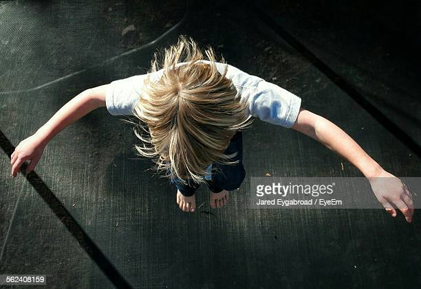 Directly Above Shot Of Girl Jumping