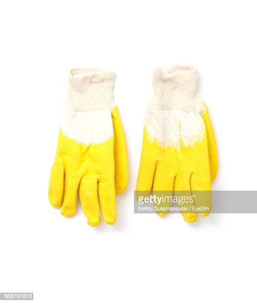 directly above shot of gloves on white background - ゴム手袋 ストックフォトと画像