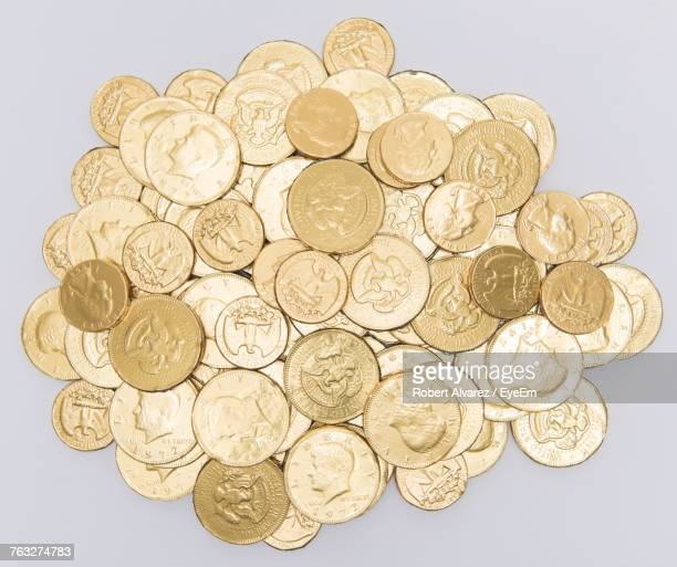 directly above shot of gold coins on white background - white gold stock pictures, royalty-free photos & images