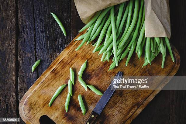 directly above shot of green beans and knife on cutting board - green bean stock pictures, royalty-free photos & images