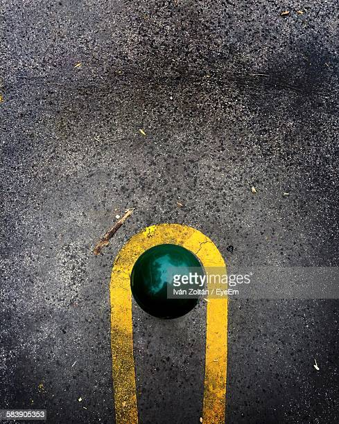 Directly Above Shot Of Green Bollard On Street