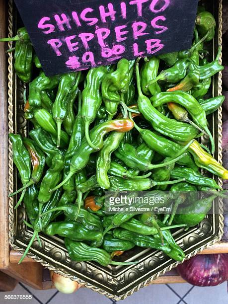 Directly Above Shot Of Green Chili Peppers For Sale At Market Stall