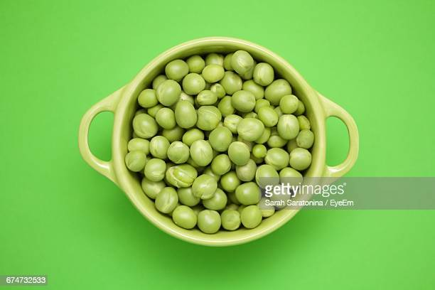Directly Above Shot Of Green Peas In Bowl On Green Table