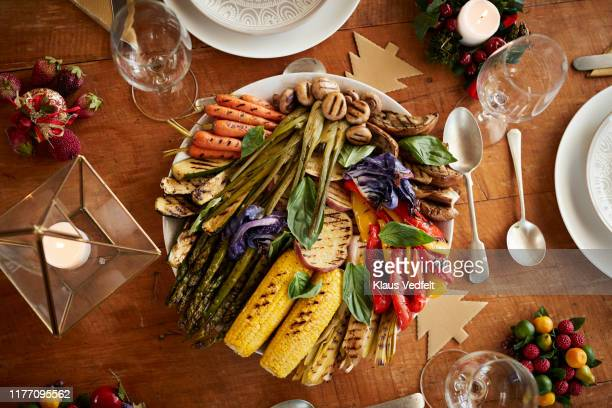 directly above shot of grilled vegetables in plate - vegetarian food stock pictures, royalty-free photos & images