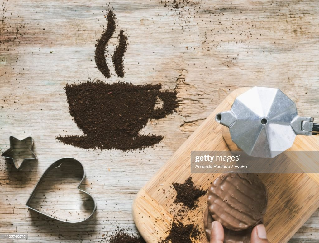 Directly Above Shot Of Ground Coffee In Cup Shape On Table : Stock Photo