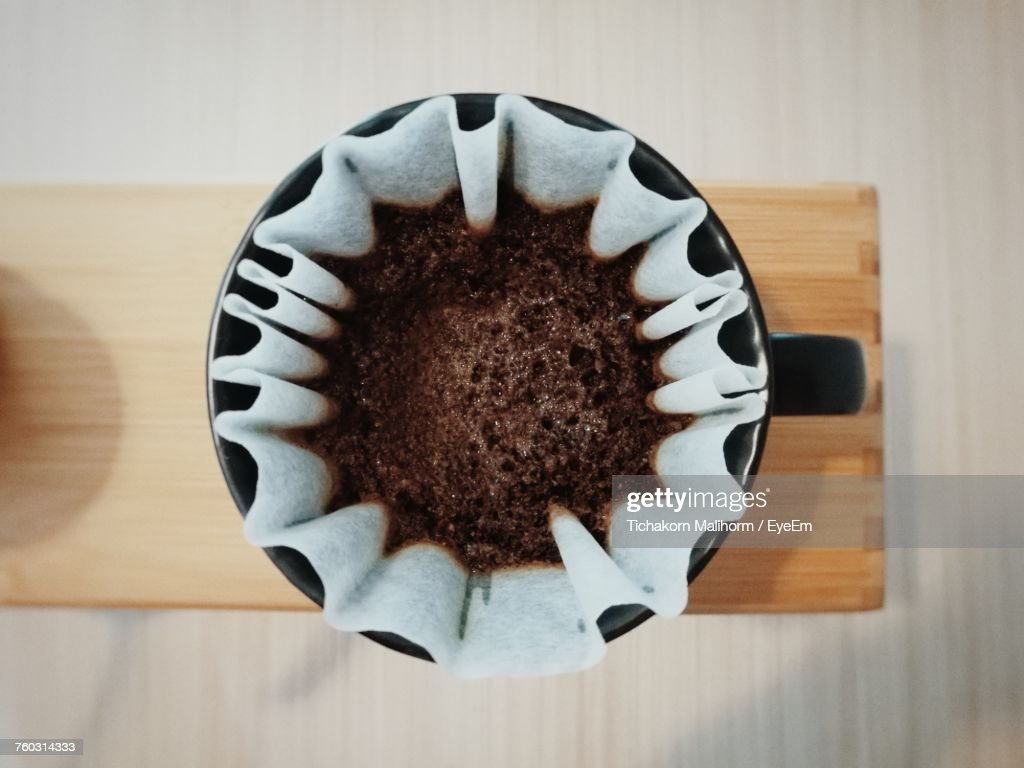 Directly Above Shot Of Ground Coffee In Filter : Stock Photo