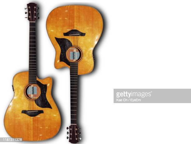 directly above shot of guitars against white background - acoustic guitar stock pictures, royalty-free photos & images