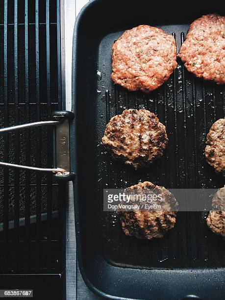 Directly Above Shot Of Hamburgers On Barbecue Grill