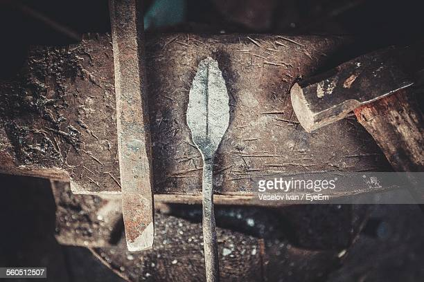 directly above shot of hammer on anvil - blacksmith shop stock photos and pictures