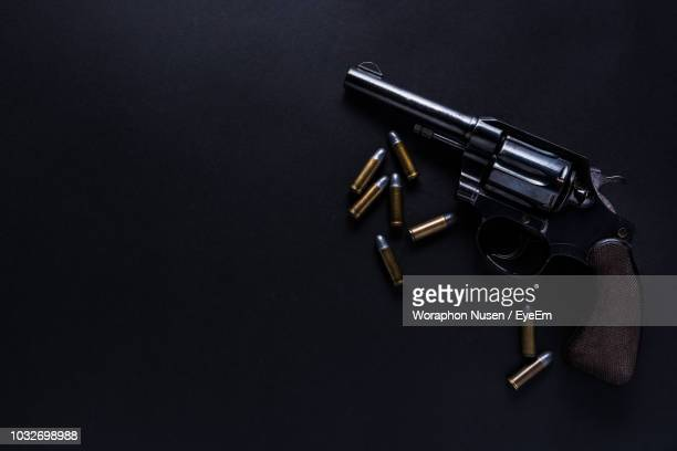 directly above shot of handgun and bullets on table - 銃 ストックフォトと画像