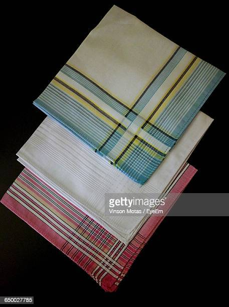 Directly Above Shot Of Handkerchiefs Against Black Background