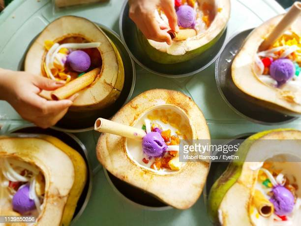 directly above shot of hands decorating food - philippines stock pictures, royalty-free photos & images